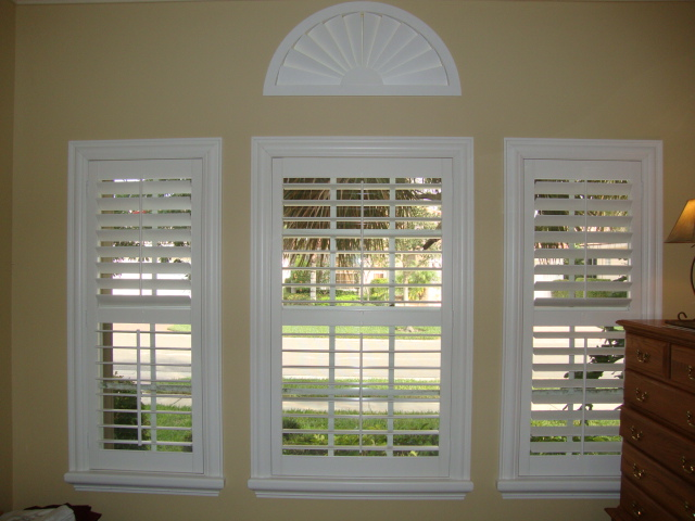 White Plantation shutters on a beige wall